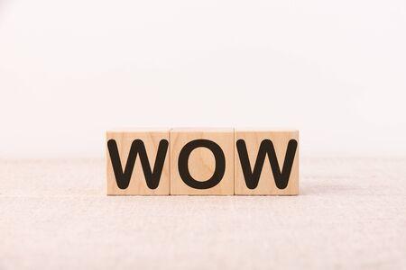 Word WOW is made of wooden building blocks. Concept. Foto de archivo