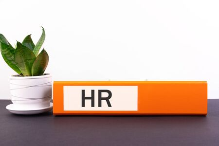 HR, human resources department, hiring a new job or position in the company concept, folder with the inscription HR.