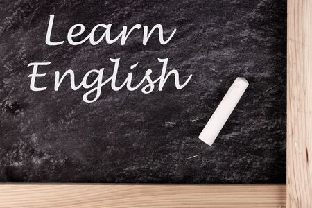 Learn English text written On Blackboard, education concept 版權商用圖片