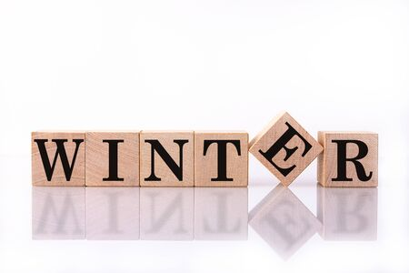 The word Winter on wooden cubes. Concept Seasons of year. Standard-Bild