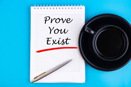 Text written in a notebook to Prove You Exist in a concept image Stock Photo