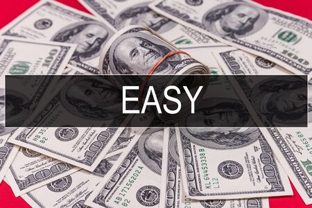 EASY text on black money background and red table