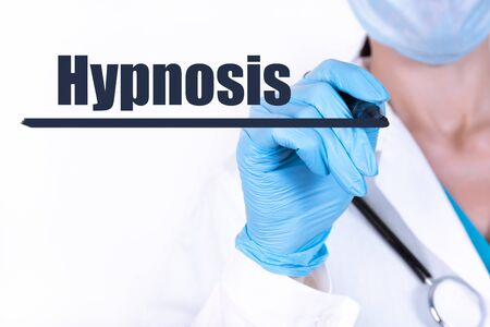 Doctor writing word Hypnosis with marker Medical concept Stockfoto - 148356767