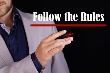 Business man with the text Follow the Rules in a concept image
