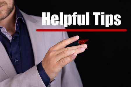 HELPFUL TIPS text written by businessman hand with marker. Business concept.