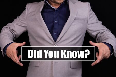 DID YOU KNOW text is written on the background of a businessman in a gray suit. Business concept