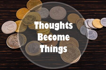 Inspirational quote on a money background. Thoughts Become Things.
