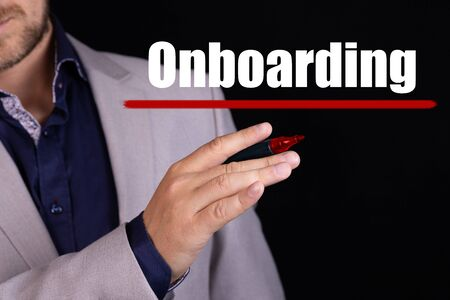 ONBOARDING text written by businessman hand with marker. Business concept.