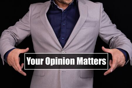 YOUR OPINION MATTERS text is written on the background of a businessman in a gray suit. Business concept