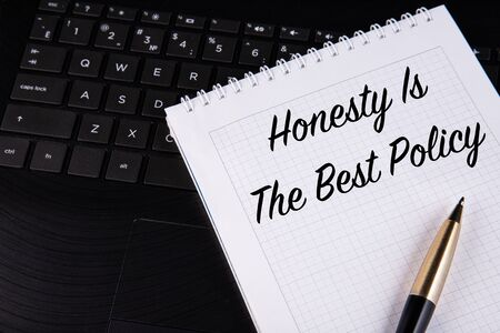 Honesty is the best policy - written on a notebook with a pen. High quality photo