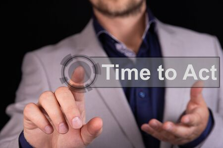Businessman presses a button finger with the text TIME TO ACT. Business concept.
