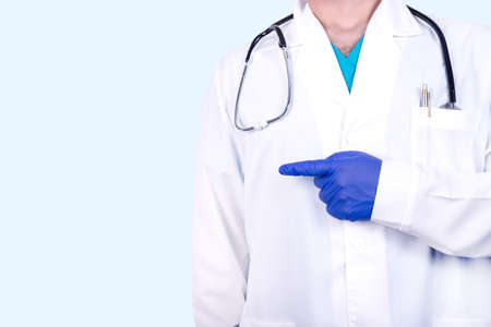 Doctor, venerologist points with a gesture of his hand to a place for text. Medical concept.