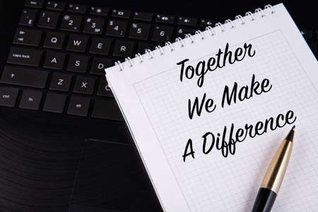 Together We Make A Difference - written on a notebook with a pen. 免版税图像