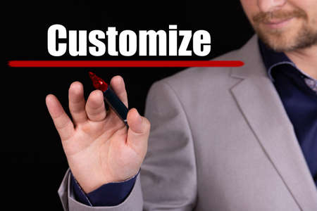 Businessman, man writes marker text on the word CUSTOMIZE. Business concept, stteryria.