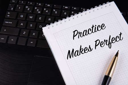 Practice Makes Perfect - written on a notebook with a pen.