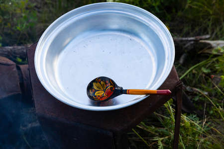 Touristic spoon and metal bowl. Travel concept. 스톡 콘텐츠