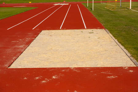 Sand pit for long jump in the stadium. Track and field athletics concept. Stock fotó