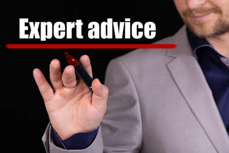Businessman, man writes marker text on the word EXPERT ADVICE. Business concept, stteryria.