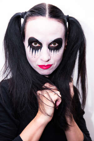 Beautiful woman, girl with makeup on her face. Halloween holiday concept. 스톡 콘텐츠