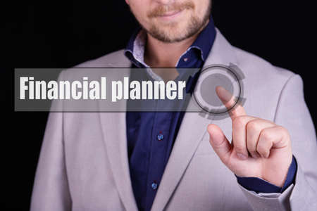 Businessman presses a button with the text FINANCIAL PLANNER. Business concept.