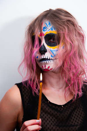 Beautiful woman, girl with makeup on her face in the image of a Dead Bride. Mexican culture, carnival. Halloween holiday concept.