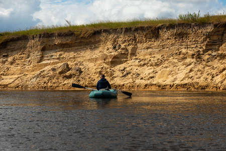 Rafting down the river on an inflatable boat on the European river.