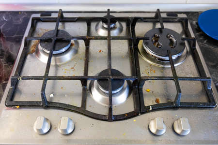 Dirty gas stove burners in kitchen room