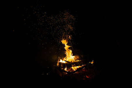 Bonfire flames on a black background. The concept of memory, mysticism.