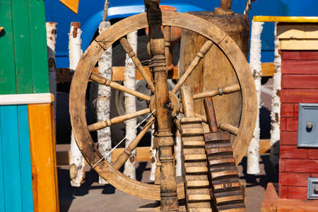Vintage spinning wheel, machine, on a beautiful authentic background Stock Photo