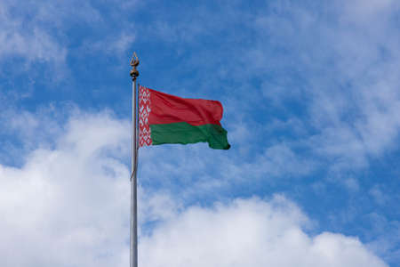 Big state wind flag Republic of Belarus in Europe on blue sky background, copy space