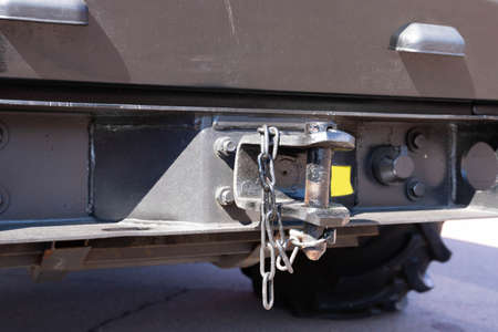 Black hairpin, hook for closing a semi-trailer close-up. Truck parts concept. Selective focus