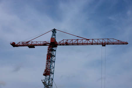 Tower crane on the background of the sky. Construction concept.
