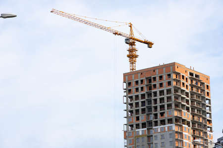 tower crane on the background of a house under construction Archivio Fotografico