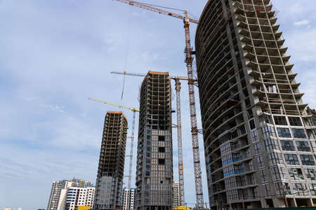 tower crane on the background of a house under construction Archivio Fotografico - 155924784