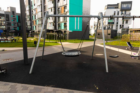 Modern children's playground in a residential building, complex.