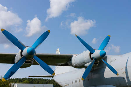 Wing and propellers of a civilian old aircraft.