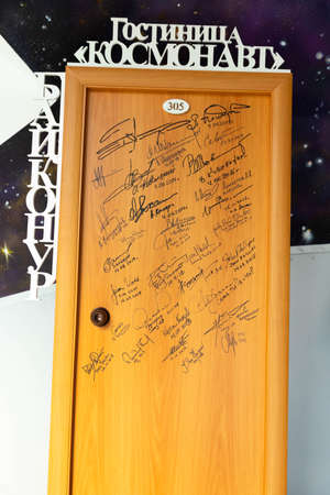 Minsk, Belarus - September 20, 2020: The door with real signatures of the heroes of Soviet and American pilots and cosmonauts. Text space. Archivio Fotografico - 156499700