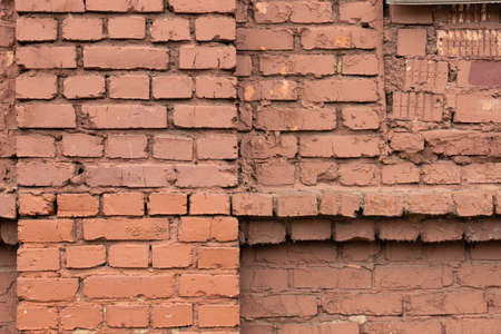 Old grunge brick wall made of old red bricks. Archivio Fotografico