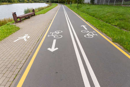 Bicycle and footpaths and white bicycle symbol.