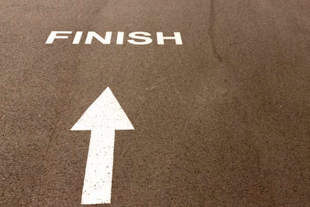 The white directional arrow points to the word Finish. Selective focus.