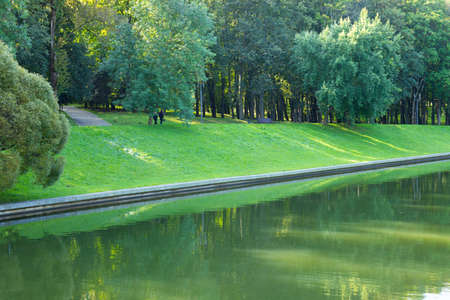 City European park with green lawn and trees. Archivio Fotografico