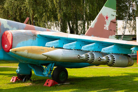 Minsk, Belarus - September 20, 2020: Rockets, bombs, rocket launchers and other guided and unguided weapons of an old Soviet jet fighter jet.