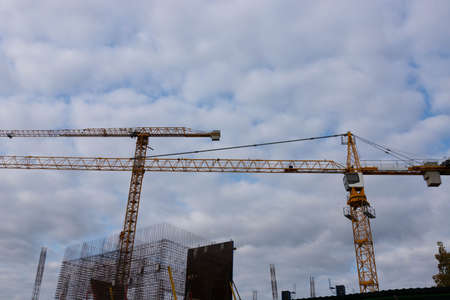 Construction tower crane on the background of the sky. Construction concept.