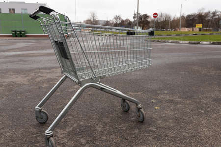 Empty grocery cart from a supermarket on the street