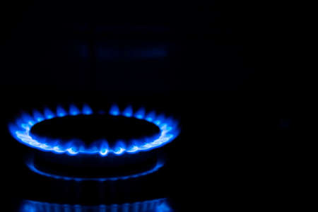 Gas flame, burning gas stove burner on a black background. Copy space. Stock Photo
