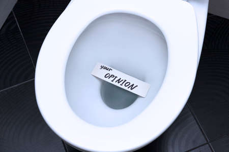 The words, the phrase, YOUR OPINION is written on the note card and floats in the toilet bowl as a reminder of the importance of customer feedback.
