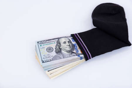 Money sock. a bundle of American hundred dollar bills hidden in a sock. Savings and storage concept. Selective focus