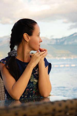 Happy caucasian beautiful woman in a blue summer dress. Pretty sexy fashion model. Montenegro, Tivat.