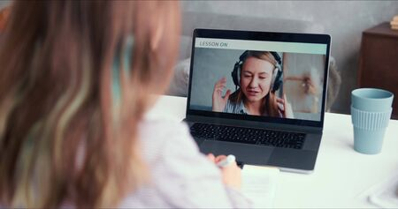 E-learning and self isolation. POV teen age girl speaks to beautiful female teacher on laptop web conference app online.