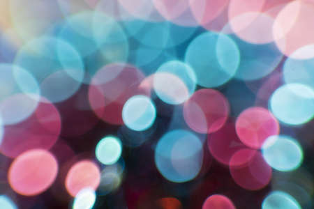 The photo shows bokeh in the form of circles surrounded by light and glow